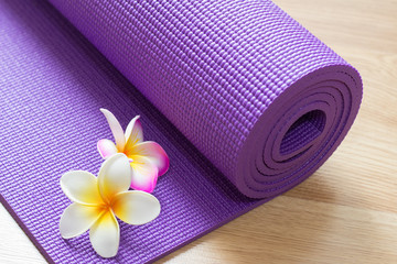 yoga mat on wood floor