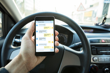 Person Sending Text Message In The Car