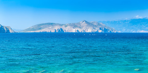 Wonderful romantic summer afternoon seascape Adriatic island. Yachts in harbor at cristal clear turquoise water. Baska on the island of Krk. Croatia. Europe.