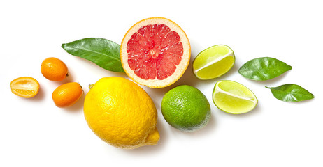 various citrus fruits on white background