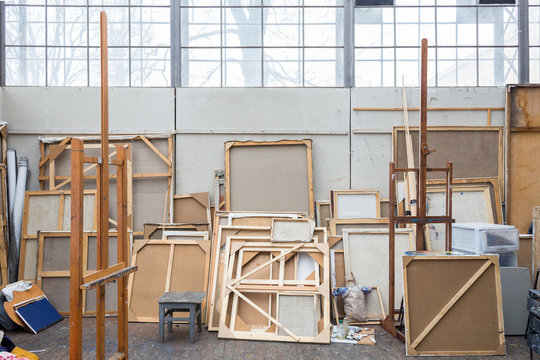 Daylight Artist Studio Interior with Stretched Canvases and Stuff