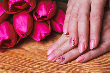 Pink nail art with flowers