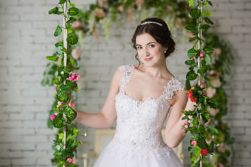 Smiling bride holding big wedding bouquet