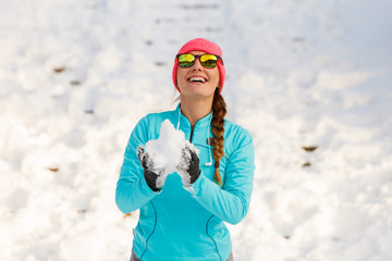 Young female holding snow