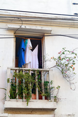 Clothes hang to dry on a balcony in Cartagena, Colombia.