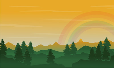 Silhouette of hill and spruce with beauty rainbow