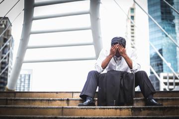 Bankruptcy or Depressed Businessman Walking Stairs way outdoor, Tired businessman Walking modern sky walk background