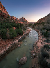Vertical of Zion National Park with river flow in sunset