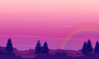 Silhouette of hill with rainbow scenery