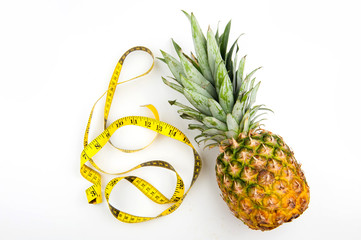 pineapple and centimetre on a white background