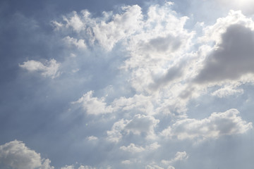 White curly clouds in a blue sky