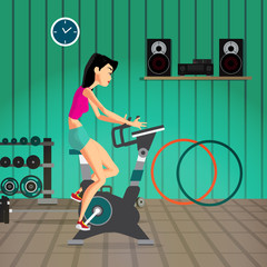 Caucasian woman riding stationary bicycle in the gym. Sporty gir