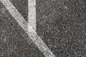 Corner of white lines on asphalt