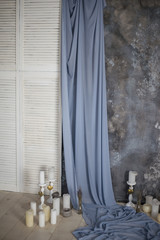 Curtain, candle and wall