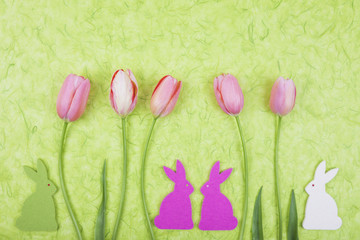 Wall Mural - Easter bunnies sitting under bouqet of tulips