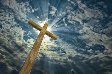 Cross against the sky. Happy Easter. Christian symbol