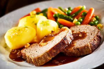 Dinner of Meatloaf, Potatoes, and Mixed Vegetables