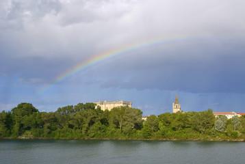 Rainbow above king's castle and St Martha's Church. Tarascon. France