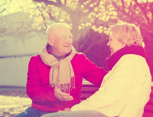 Mature couple talking in park