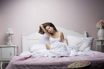 Girl on the bed with a pillow