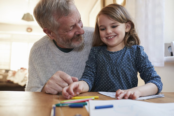 Grandfather And Granddaughter Colouring Picture Together
