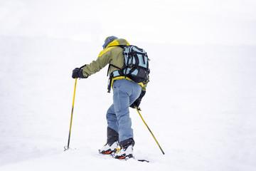 Skier climbing slope