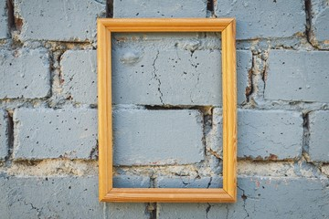 Brick wall texture background with picture frame. Macro shot.