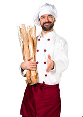 Young baker holding some bread and making a deal