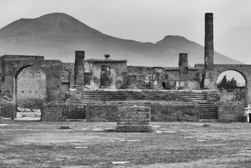 Pompeii,Temple of Jupiter with Vesuvius in the distance.