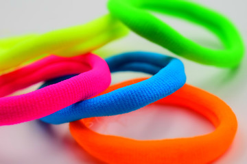 Some fluorescent elastics on white background. Tilt-shift effect applied.