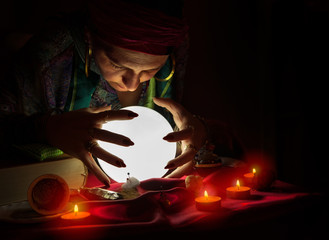 Gypsy woman looking at crystal ball,reading the future
