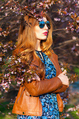 beautiful blond woman in the park on a warm spring day
