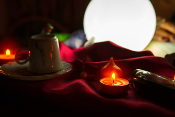 Crystal ball and candles for fortune telling