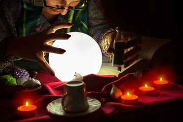 Fortune teller woman staring at crystal ball