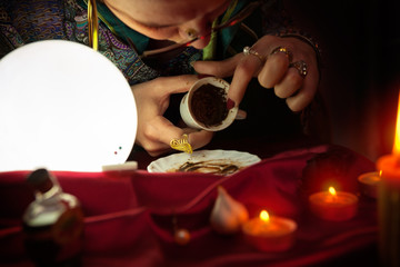 Fortune teller reading fortune from an empty coffee cup