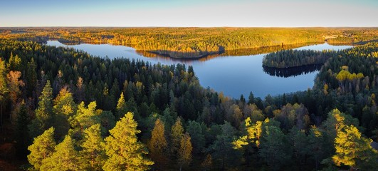 Peaceful panorama lake view with fall colors at Aulanko nature park in Finland