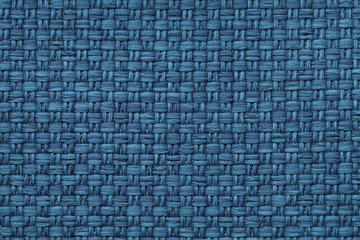 Navy blue background with checkered pattern, closeup. Structure of the fabric macro.