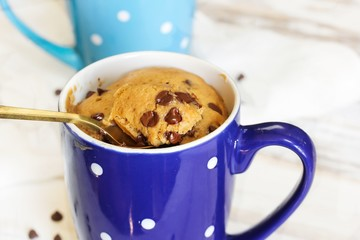 Chocolate chip Microwave Mug Cake, selective focus