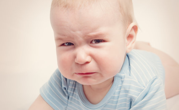 Eight month old baby crying