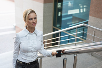 Beautiful Business woman climbs the stairs