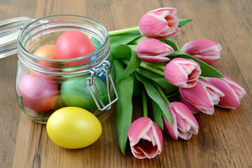 Easter eggs bunch of pink tulips wooden background
