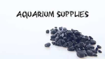 Aquarium Supplies Shop Header with Some Black Gravel on a White Background