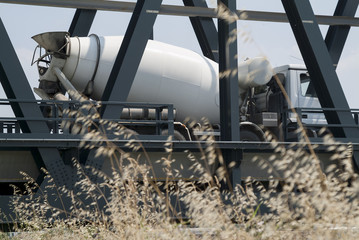 Cement mixer in transit on the metal bridge