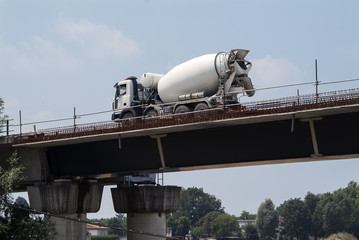 Cement mixer in transit on overpass under construction