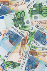 European money - a lot of Euro banknotes background