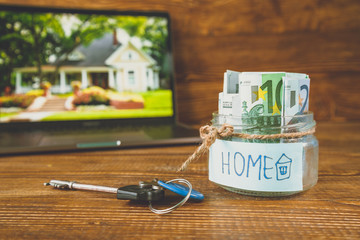 save money in jar for house, image of a house in laptop