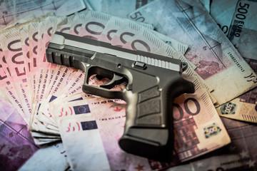 500 euros bank notes with 9mm gun