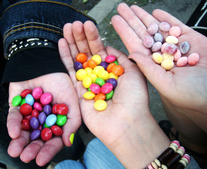 Sweet candies in the hands bright photo