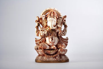 Ganesha sculpture indian lord ancient at white background