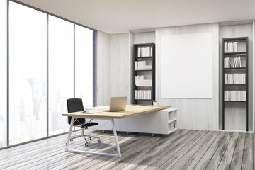 Corner of a CEO office with gray walls